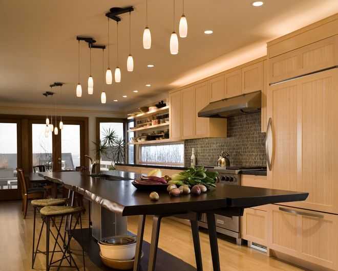 Finne architects seattle the kitchen design relies on the creation of a very simple continuous - Kitchen designers seattle ...
