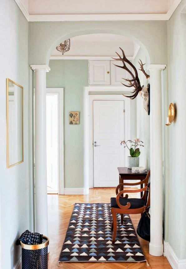 Mint hallway with antlers