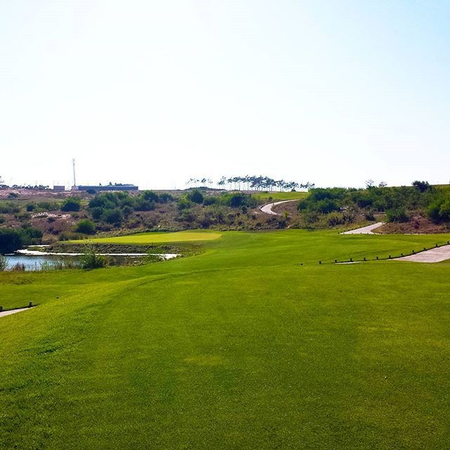 A par 3 challenge hole 7 of #RoyalObidos. Beautiful golfcourse to play. What is your favorite par 3? Want to hit close to the green? Download golf shortgame tracker for free at http://goo.gl/Ouiz8 the #1 golf shortgame app available.  #golflife  #golftoday  #golfcoursephotography #practicet2improve #playgolf #golf⛳️ #lovethisgame