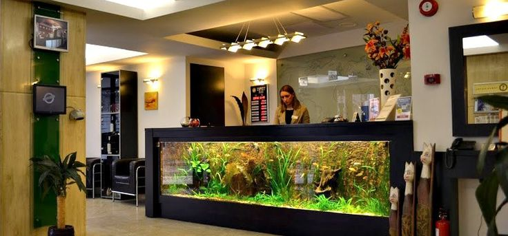 The aquarium reception desk at the entrance of the hotel ...