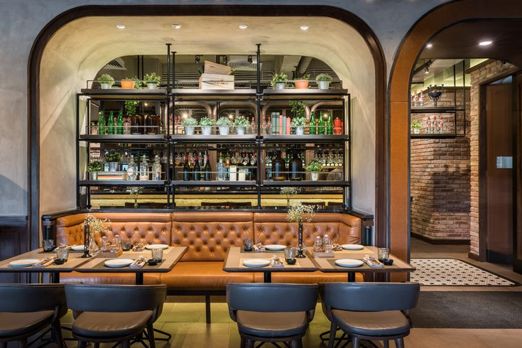 Combining brown leather couch and hanging rack as wall separator with Ambiente Ristorante's ambience make this project interesting. Every detail is a way to help this restaurant more intimate to the guests.