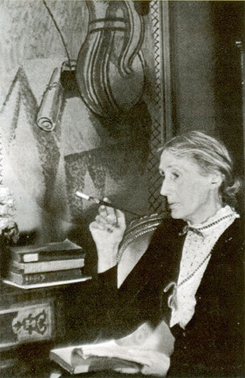Virginia Woolf with Vanessa Bell's painting in the background.