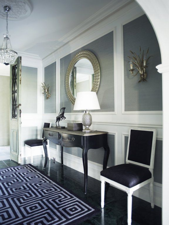 @Greg Natale designed foyer. Love the touches of black, grey grasscloth and sparkly mirror and wall sconces.