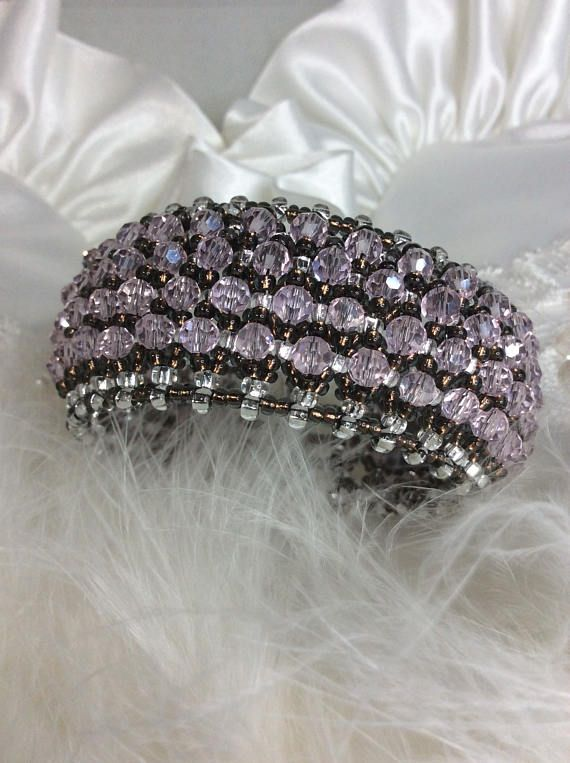 This bracelet is absolutely stunning!!!!!! This layered bracelet was made by embellishing a netted base of seed beads with soft pink crystal beads. Each bracelet takes several hours to complete. Each crystal is hand sewn onto glass seed bead netting which is also hand sewn .