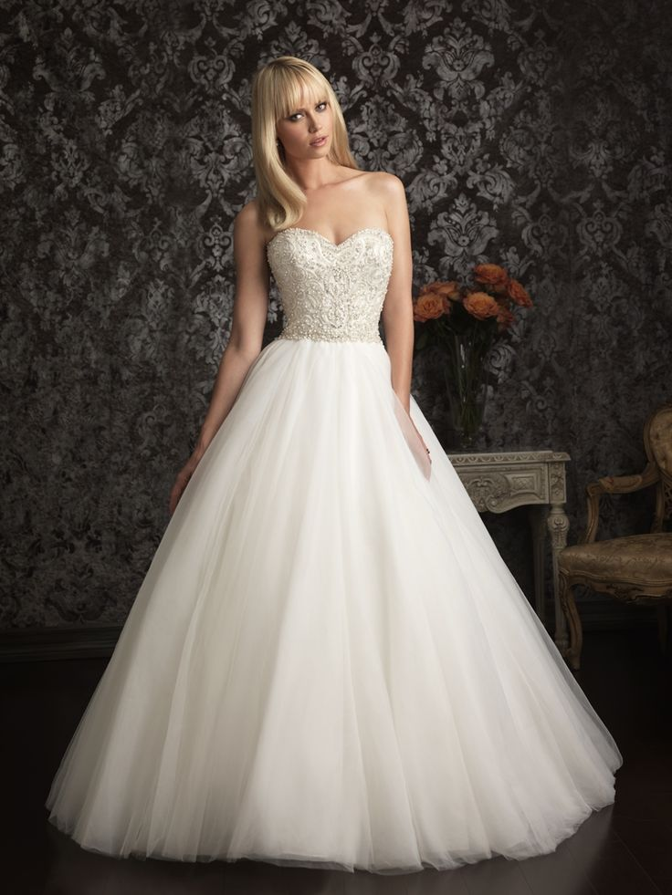 Allure Bridals, 9006; A beautiful ball gown in English Net. The natural waist bodice is embellished with intricate embroidery and Swarovski crystals while the skirt is lightly gathered for a romantic look.