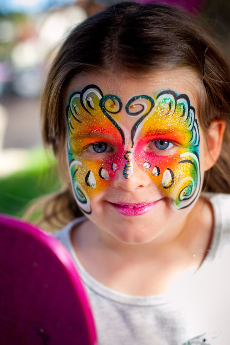 Rainbow butterfly face painting design, by Brisbane face painter, Fairy Sparkles Face Painting.