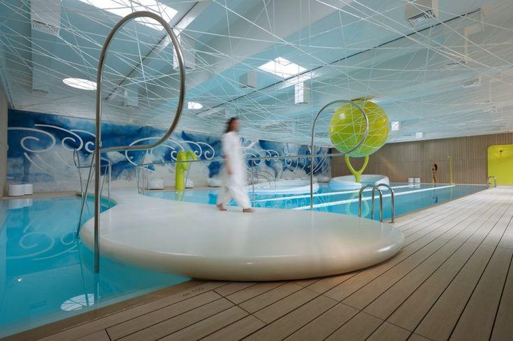 Italian architect Simone Micheli has completed a new wellness center in the Park Hotel ai Cappuccini in Gubbio, Italy.