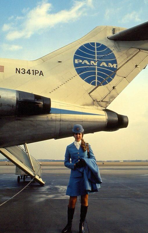 Pan Am stewardess, designed by Edith Head. A distinctively classy look... Truly the glory days of commercial aviation...