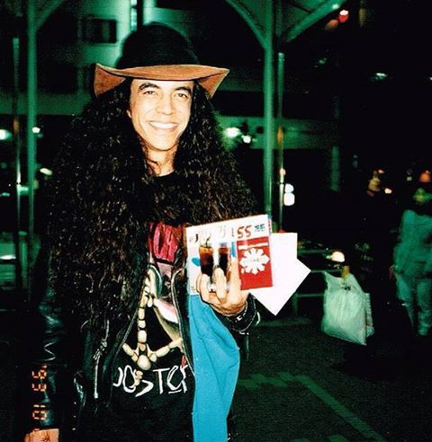 Smiling Mike Inez with an AIC Rooster t-shirt