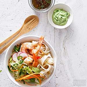 A spicy wasabi dressing coats the vegetables, noodles, and shrimp in this low-calorie, low-fat meal. For even more heat, substitute wasabi peas for the cashews. /