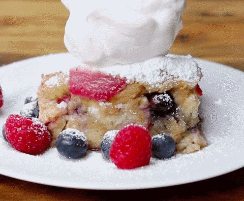 Not to mention a perfect ~plop~ of whipped cream. | This French Toast Bake Is Filled With Berries And Possibly Magic