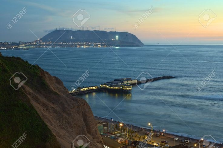 12325299-The-coastline-of-Lima-Peru-at-twilight-with-the-Restaurant-La-Rosa-Nautica-reaching-into-the-sea-on--Stock-Photo.jpg (1300×866)