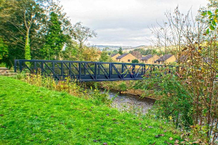 The bridge named after the former owner of the toll house Mr Graham Wilson is the replacement for the former Copley Toll Bridge that stood from 1831 until damaged beyond repair by the Calder Valley Boxing Day Floods in 2015. The picture was taken from St Stephens Church yard and Copley Village can be seen beyond the bridge and River Calder. More of my pictures and information can be seen at, www.colingreenphotography.blogspot.co.uk