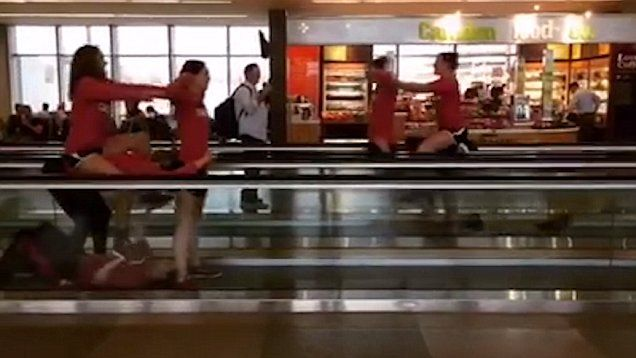 Video footage uploaded to Facebook shows the hilarious travelator stunts carried out by a University swimming team who were bored at the airport.