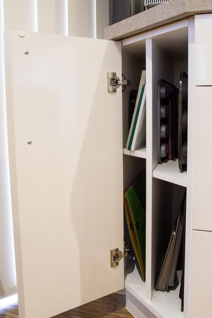 Contemporary kitchen. Odd corner cabinet storage. Perfect for chopping boards and baking trays. www.thekitchendesigncentre.com.au
