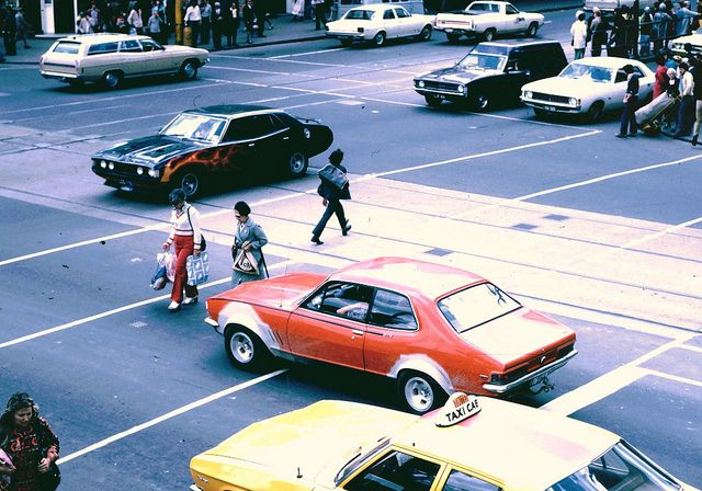1975, Flinders St Melbourne. Check out all the old Aussie muscle cars! LC Torana GTR Classic!