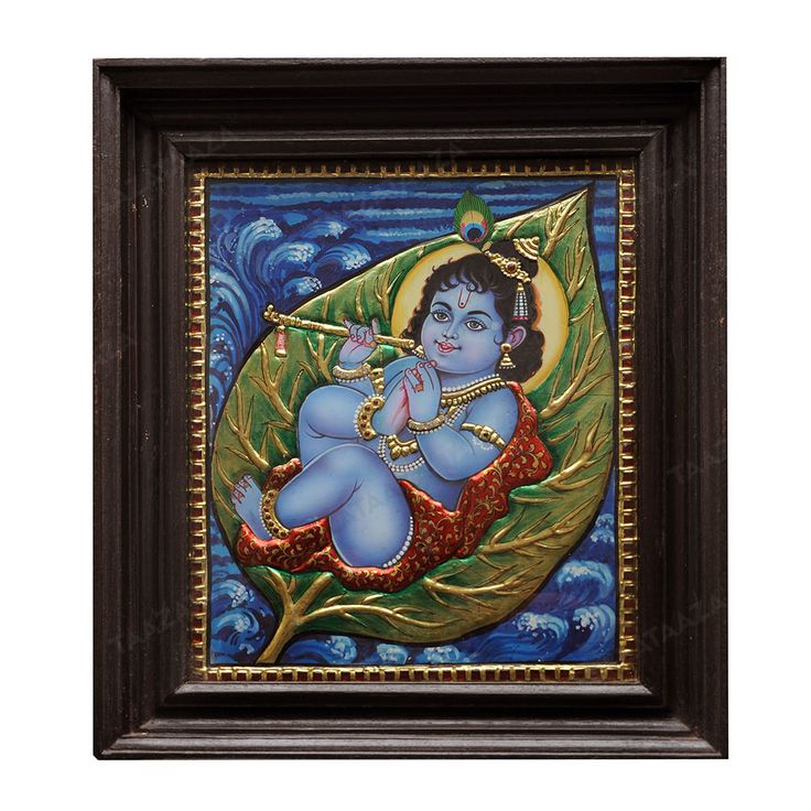 Leaf Krishna | Tanjore Painting |  Material: Jaipur stones Material Of Frame: Teak Wood with Glass Frame Dimensions( LxW): 14X16 Inches Package Contents: 1 Leaf Krishna Painting