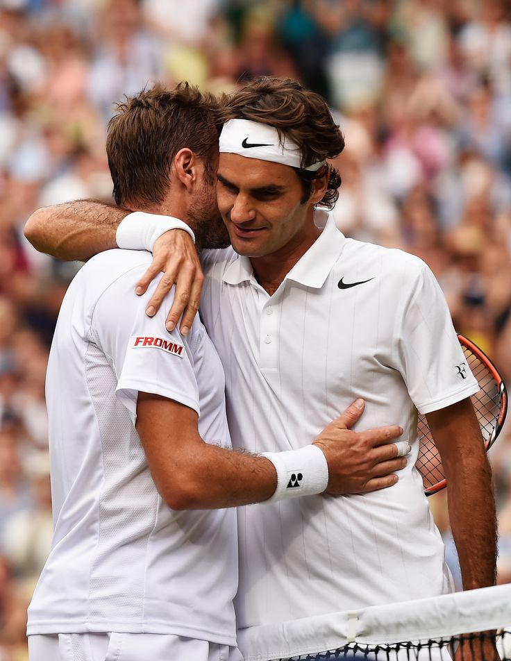Roger Federer of Switzerland hugs Stan Wawrinka of Switzerland after their Gentlemen's Singles quarter-final match on day nine of the Wimbledon Lawn Tennis Championships at the All England Lawn Tennis and Croquet Club at Wimbledon on July 2, 2014 in London, England. (Photo by Pool/Getty Images)