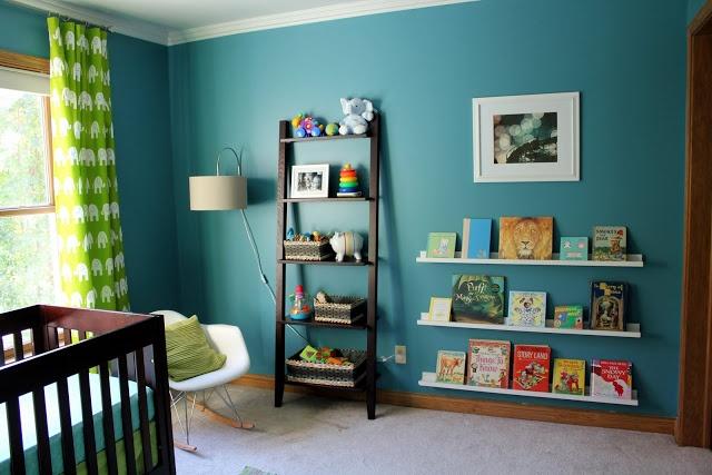 dark teal nursery with brown furniture