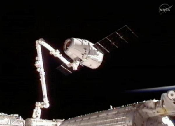 NASA: Three days, six hours, 11 minutes, and 23 seconds after launching from Cape Canaveral Air Force Station in Florida, the privately-funded spacecraft Dragon was successfully captured by the robotic arm of the International Space Station as it orbited the Earth 251 miles over northwest Australia, NASA said. Dragon is now the first private spacecraft to dock at the International Space Station. Docking was considered to be the most challenging aspect of Dragon's mission.