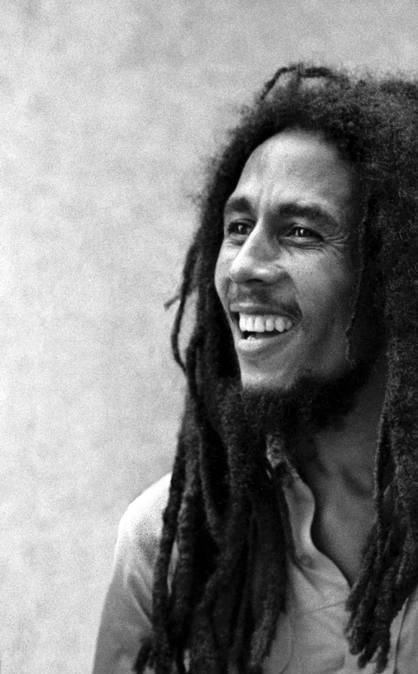 Bob Marley. He had the most amazing smile haha I'm in love ;)