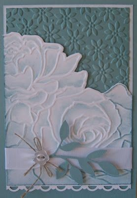 """By Ann Craig. Uses the Stampin' Up/Sizzix """"Manhattan Flower"""" and """"Lattice"""" embossing folders. There's a link from her website to her tutorial."""