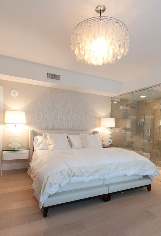 All the white and the light wood floors in this room help give the room a luxurious feel. My absolute perfect master bedroom. Love it!!