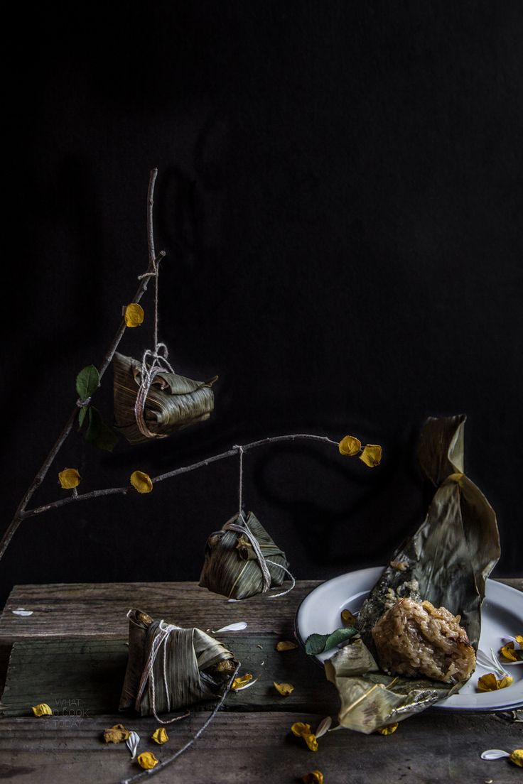 Steamed Rice dumplings are traditionally stuffed with pork, dried shrimp, chestnut ,shiitake mushrooms, salted duck egg yolk, chili and wrapped in bamboo leaves for Dragon Festival celebration (duan wu jie)