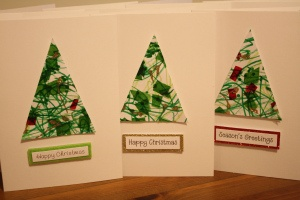 homemade Christmas cards made with some toddler intervention