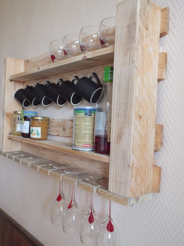 Pallet kitchen shelf ... just cut a piece of a pallet, add two boards (of the same pallet), one you cut paths/notches in so it can receive stemware. Some nails or cuphooks to hang cups....sand a bit, and then hang the shelf on the wall !