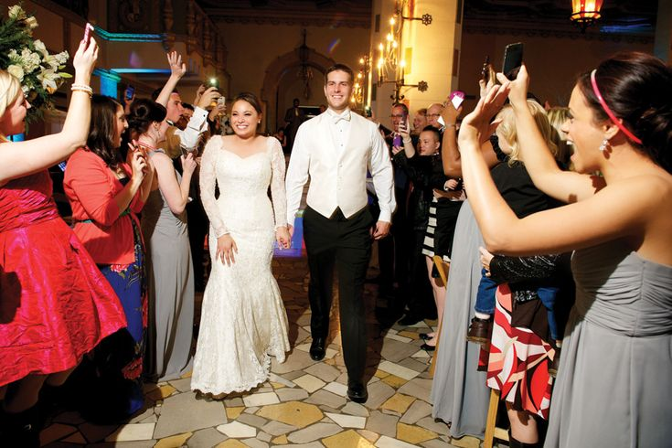 A great wedding exit isn't about all the fuss, it's about the friends and family. Look at those smiles!
