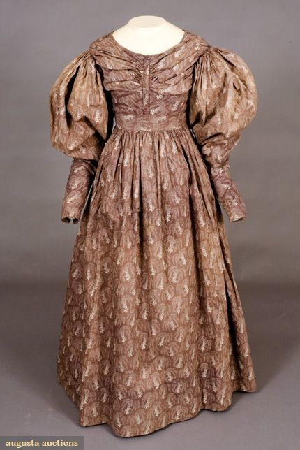 Printed Plum Cotton Dress, 1830's Tasha Tudor Historic Costume Collection - Augusta Auctions Plum printed w/ white abstract leaf sprays, piping on bodice, skirt gathered into inset waistband.