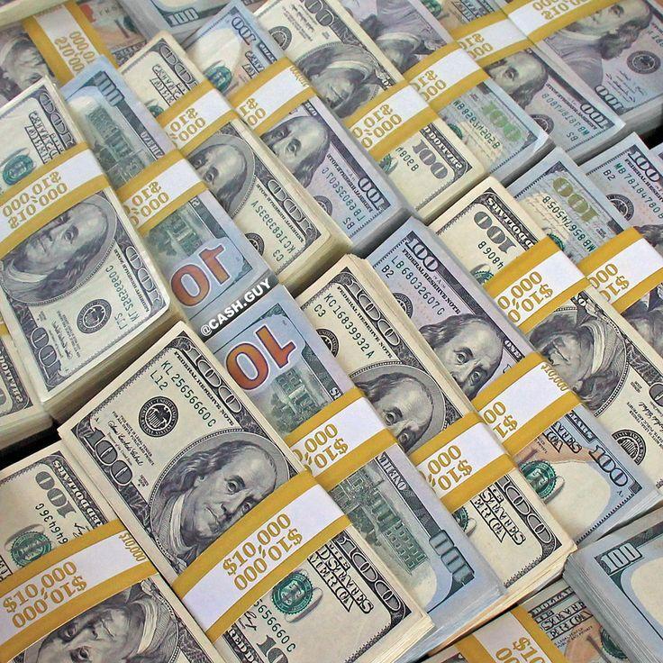 Load of cash! Huge money stacks. $100 dollar bills…