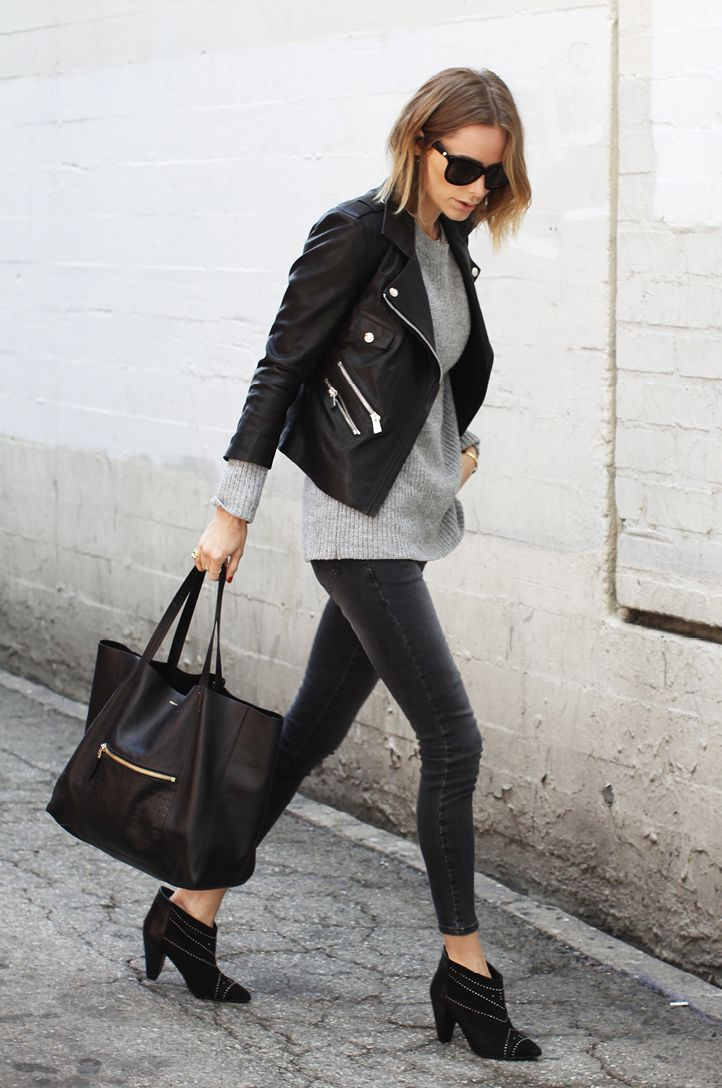 Grey jacket, black long tank, extender?, long sleeved shirt, black pants, boots.