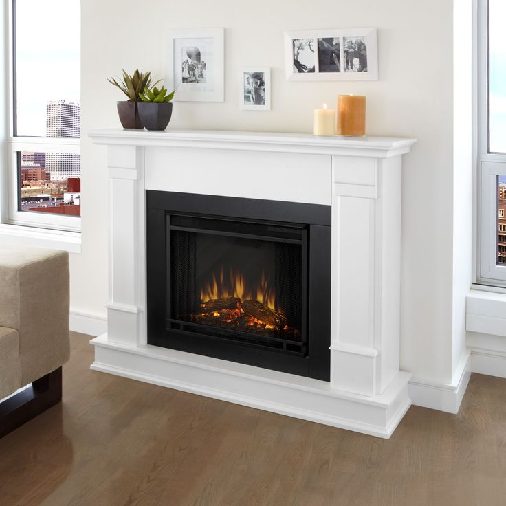 Get cozy with a loved one in front of this elegant real flame electric fireplace. With a classy design featuring stately pillars, this electric fireplace includes a remote control with programmable brightness and thermostat settings.