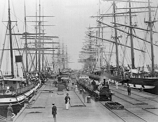 [Sailing ships and a steam train at Sandridge Pier, Port Melbourne, circa 1880.]