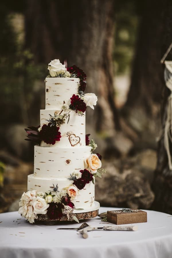 Wedding cake portrait of a four tier, rustic bark themed wedding cake with a carved heart created by Lake Tahoe Cakes