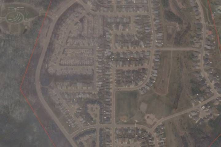 Fire ravaged the western parts of Fort McMurray's Wood Buffalo neigbourhood. Damage is clearly visible in this image taken from space on Thursday afternoon.
