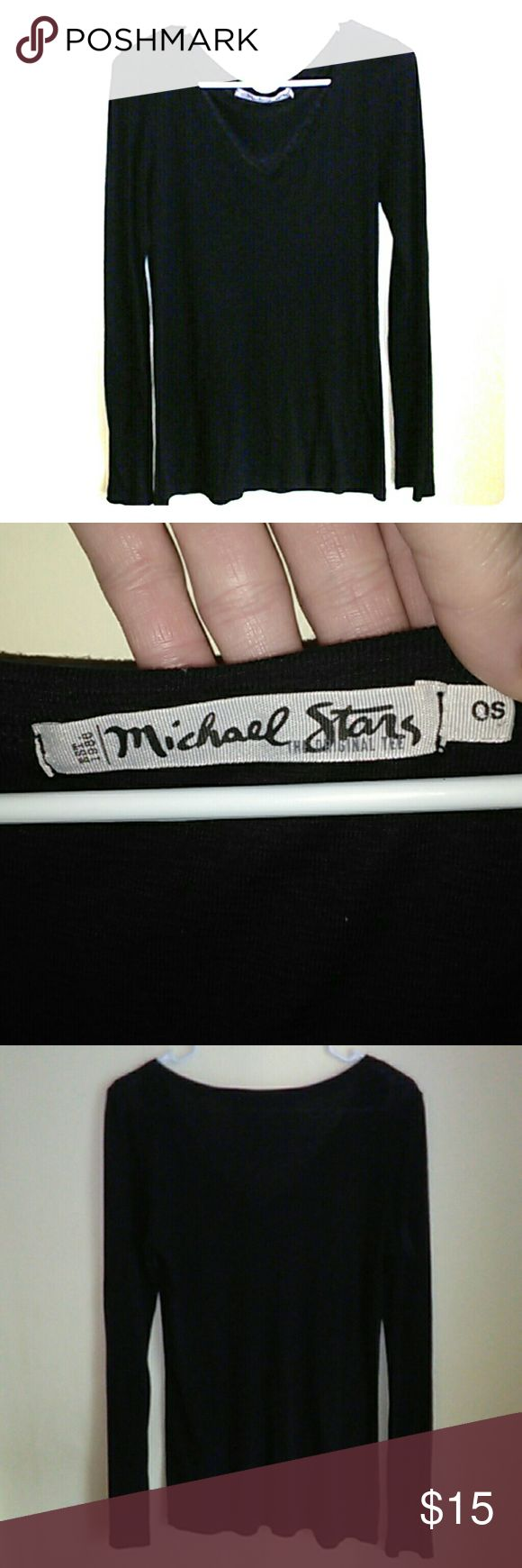 Michael Stars 🌟🌟Black Long Sleeve Top OSFM Michael Stars 🌟🌟Black Long Sleeve Top OSFM. Such a nice, quality made top but I have so many black tops, (including 2 more Michael Stars just like this), that I sadly have to get rid of it. Excellent condition, only worn twice. Says OSFM & I'm a medium in tops and a 36C & it fits me snug but could definitely stretch to fit a large. Michael Stars Tops Tees - Long Sleeve