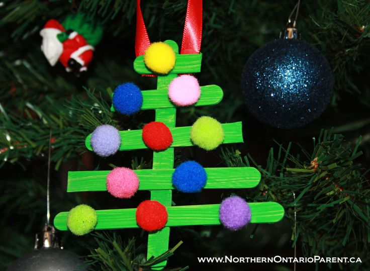 Popsicle Stick Christmas Tree - Craft for Kids  Here's how to make it: http://www.northernontarioparent.ca/#!craft--popsicle-stick-christmas-tree/cpoo