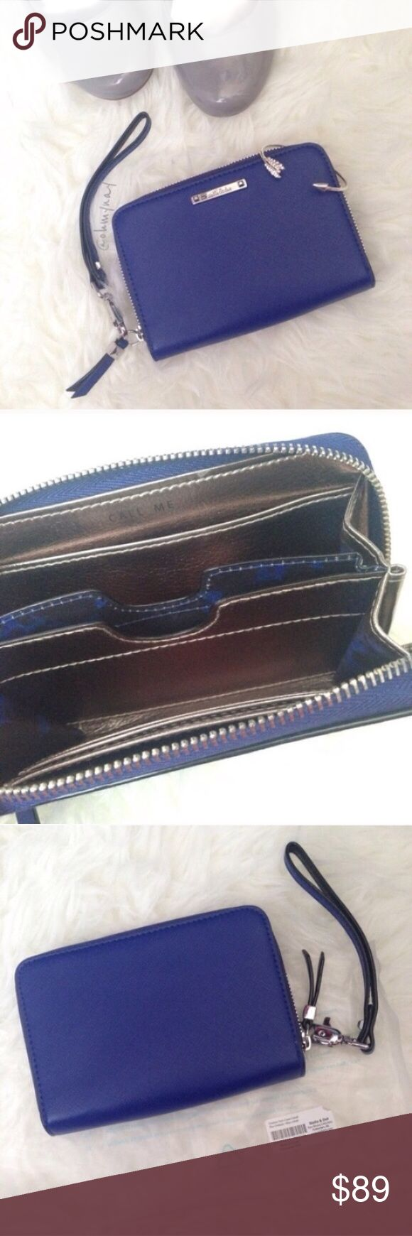 "Stella & Dot • Cobalt Blue Chelsea Tech Wallet Tech-friendly wallet for everyday use. Holds your phone, cash, and cards. Features zip-around closure, signature clover lining and removable wristlet.     • Ori. $59 RETIRED & SOLD OUT • Measures: 6"" x 1.5"" x 4""   • Genuine saffiano leather • Cobalt Blue    💕 Sample with original packaging. Ships from a pet/smoke home.   Free shipping available!   🌟 Love it but not the price? Use the offer button and buy it today! Stella & Dot Bags Wallets"
