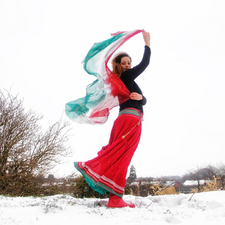 Using the rare opportunity of snow for a tiny spontaneous Photoshoot.  Thanks to @dm.vinokurov  for being as crazy as me.  And yes. I am totally rocking crocs-wellies with my Gopi skirt.       #crocs #wellies #gopiskirt #gopiskirtsbyradhika #red #scarf #wind #hair #photoshoot #skirt #ireland #snow #winter #bollywoodstyle #colouful #indian #dress #natural #colour #dance