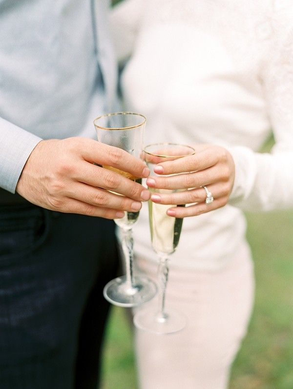 A Champagne Toast to Celebrate their Engagement! | Dana Fernandez Photography on @heyweddinglady via @aislesociety