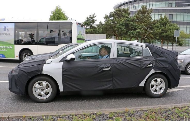2017 Hyundai Hybrid side  Hyundai is working on a committed hybrid of its own for the year 2017, and the 2017 Hyundai Hybrid hatchback appears like the car that will fit in the same cast as its rival, the Toyota Prius #hyundai #hybrid #hyndaihybrid