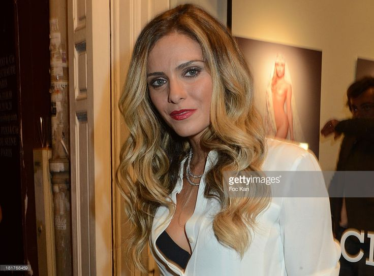 Clara Morgane attends the 'Clara Morgane 2014 Calendar' : Launch And Party At the Galerie Hug on September 24, 2013 in Paris, France.