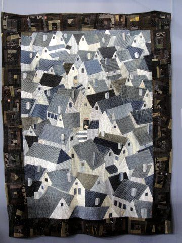 "Reiko Nishida. The center of the quilt is made from denim jeans! The border is made from a traditional Japanese fabric called ""Kurumekasuri"""