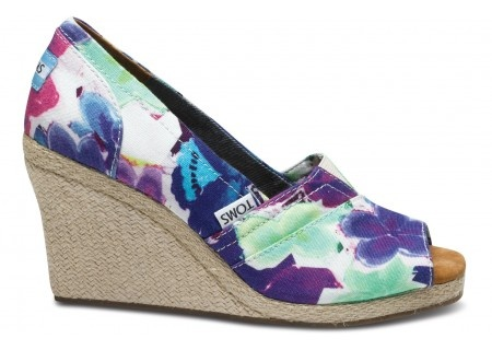 The soft-yet-salient watercolor floral print of the Purple Corbel Wedges puts a colorful accent on practical comfort.