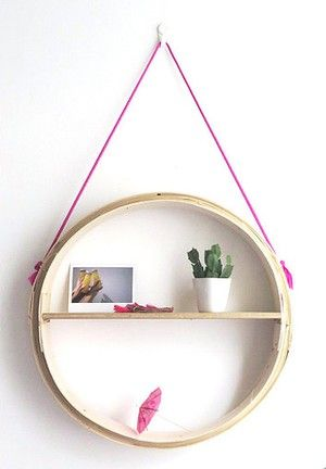 "Make a hanging shelf from a bamboo steamer basket. [photo: <a href=""http://apairandasparediy.com/2014/08/diy-round-hanging-shelf.html"" target=""_blank"">A Pair And A Spare</a>]"