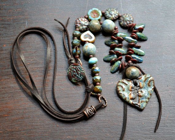 Bohemian necklace, Cottage chic, Rustic layering necklace, Glass leather, Gypsy boho, Ceramic heart pendant, Hippie, Flower child, Earthy This long bohemian necklace features a combination of earthy ceramic and glass. The rustic blue heart pendant is soft yet rustic. I continued to add pretty czech glass and coordinating ceramic beads. The longer length makes it perfect for layering. Soft leather cord keeps it casual and a czech glass button is used for a clasp. This necklace is carefree…