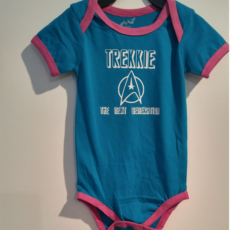 for the Star Trek loving family 12 Month short-sleeved Onesie with white transfer vinyl. 100% cotton. Wash inside out  in eco-warm water, hang or lay flat to dry for best results or tumble dry low    Please visit my shop for more listings!    Please read all our shop policies before placing an order! Shipping has been calculated for within Canada only. International or shipping to United States or International can be arranged and paid additional prior to shipping.    **This item has been…